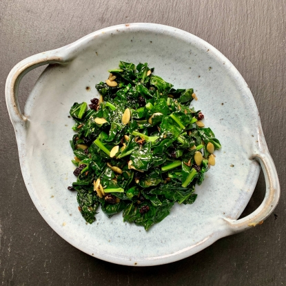 Cavolo nero with pumpkin kernels, currants, lemon and cumin