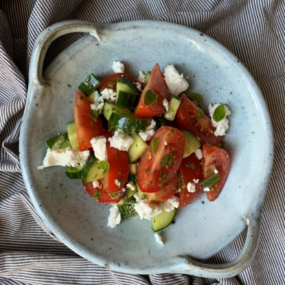 Tomato and cucumber salad with oregano and feta